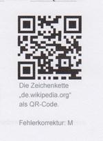 """Die Zeichenkette """"de.wikipedia.org"""" als QR-Code"""